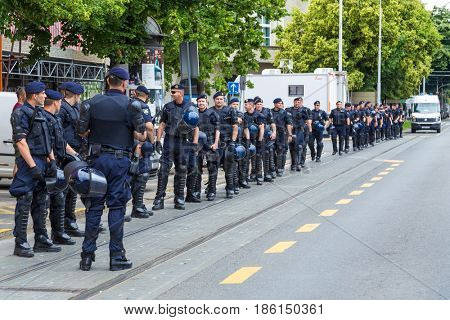 ZAGREB, CROATIA - JUNE 11, 2016: 15th Zagreb pride. Group of intervention policemen in the street.