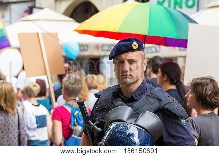ZAGREB, CROATIA - JUNE 11, 2016: 15th Zagreb pride. Intervention policeman in front of LGBTIQ activists on Ban Josip Jelacic square.