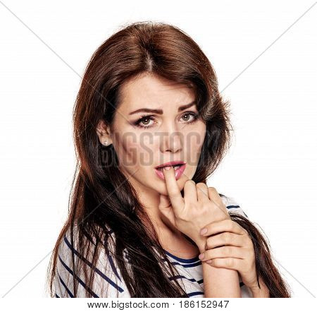 Young sad worried woman biting her finger