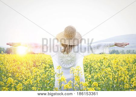 Young Woman In A Rape Field