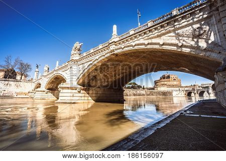 Mausoleum of Hadrian and bridge on Tiber river in Rome, Italy. The Mausoleum of Hadrian, usually known as Castel Sant'Angelo and Ponte (bridge) Vittorio Emanuele II.