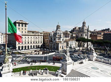 Rome, Italy - March 12, 2017 : Tourists visit Santa Maria di Loreto, a 16th century church in the historical centre of Rome, Italy