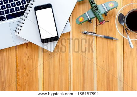 Office desk table with pen blank screen smart phone laptop leather notebook and cup of coffee.Top view with copy space.Supplies and gadgets on desk table.Working desk table concept.