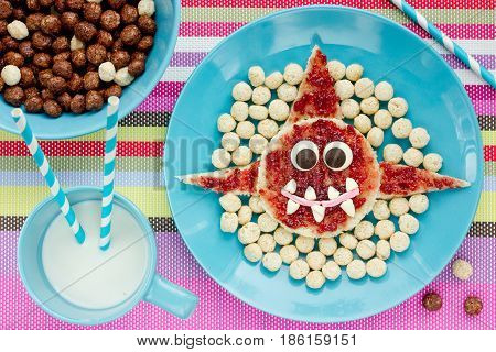 Shark toast with jam and cereal balls for creative breakfast