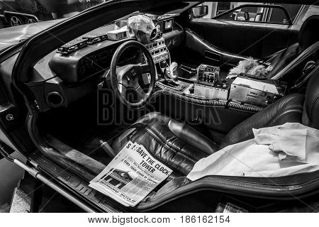 STUTTGART GERMANY - MARCH 02 2017: Cabin of the DeLorean time machine (Back to the Future franchise) based on a DeLorean DMC-12 sports car. Black and white. Europe's greatest classic car exhibition