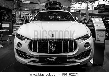 STUTTGART GERMANY - MARCH 02 2017: Mid-size luxury crossover SUV Maserati Levante S 2016. Black and white. Europe's greatest classic car exhibition