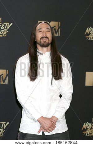 LOS ANGELES - MAY 7:  Steve Aoki at the MTV Movie and Television Awards on the Shrine Auditorium on May 7, 2017 in Los Angeles, CA