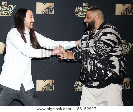 LOS ANGELES - MAY 7:  Steve Aoki, DJ Khaled at the MTV Movie and Television Awards on the Shrine Auditorium on May 7, 2017 in Los Angeles, CA