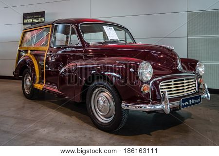 STUTTGART GERMANY - MARCH 02 2017: Subcompact car Morris Minor 1000 Traveler (wood-framed estate) 1968. Europe's greatest classic car exhibition