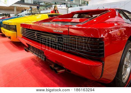 STUTTGART GERMANY - MARCH 02 2017: Rear view of various modifications of sports cars Ferrari Testarossa and F512. Europe's greatest classic car exhibition