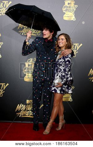 LOS ANGELES - MAY 7:  Brett Dier, Haley Lu Richardson at the MTV Movie and Television Awards on the Shrine Auditorium on May 7, 2017 in Los Angeles, CA