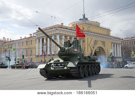 ST PETERSBURG, RUSSIA - MAY 09, 2017: Soviet tank of the Great Patriotic War T-34-85 against the background of the Admiralty building. Fragment of the parade in honor of Victory Day