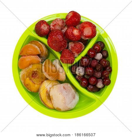 Frozen peaches apricot cherries strawberries isolated on white background photo food