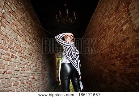 Back Of Fashionable Woman Look With Black And White Striped Suit Jacket, Leather Pants, Posing At Ol