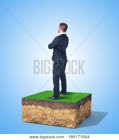 The concept of property. A man is standing on a piece of land.