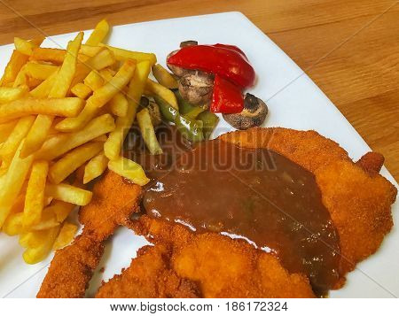 pork cutlet with fries prepared as a dish