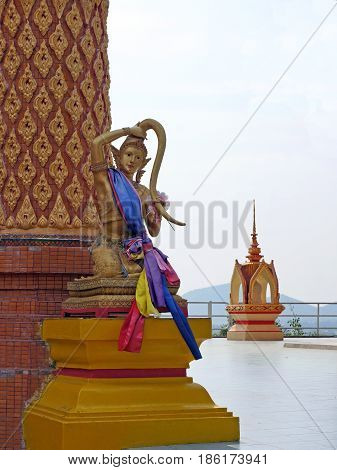 Sculpture of a mythical woman in Thailand