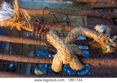 Knotted Old Rope On Rusty Machinery