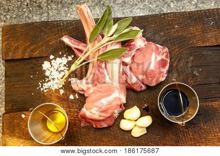 Raw Loin Of Veal, Sage, Garlic And Sauces. Meat For The Barbecue.