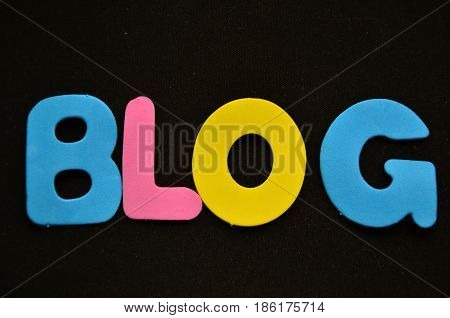 word blog on a  abstract black background