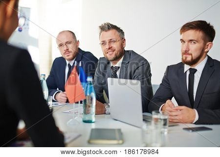 Group of delegates listening to one of political leaders