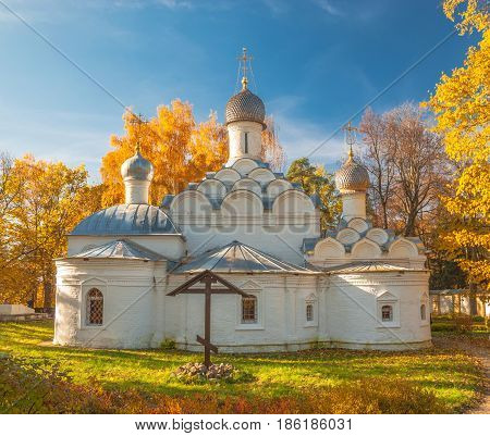 The Ancient Church of the Archangel Michael in the autumn forest