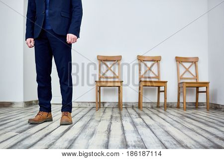 Low section of businessman in suit standing in the room
