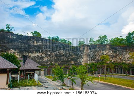 Garuda Wisnu Kencana Cultural Park. Wall Of Rock On Which There Is A Relief Image. Bali. Indonesia.