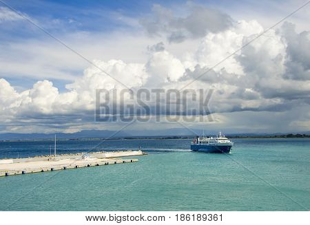 Ferry returning to port of Zakynthos island under a dramatic sky.Greece