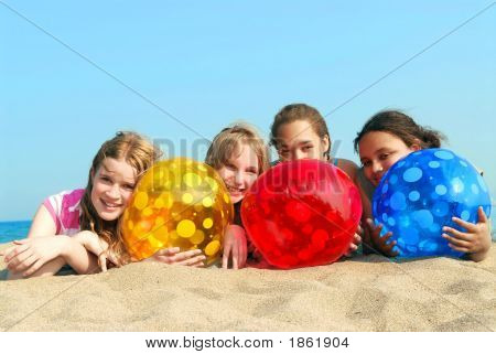 Four Girls On A Beach