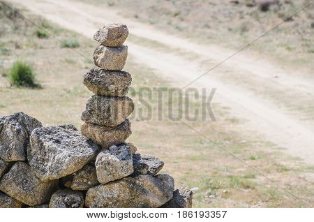 Granite Stone Pile Cairn In The Road