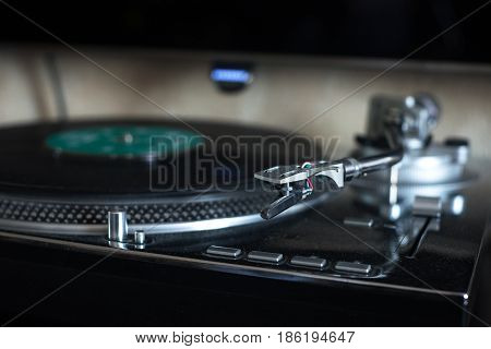 Retro vinyl records in house player closeup photo