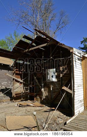 An old garage is in the process of demolition.