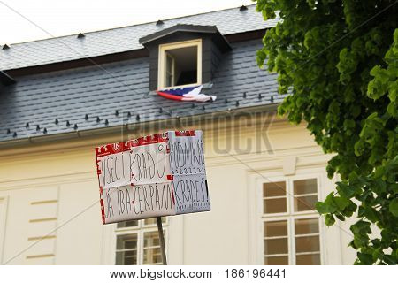 OLOMOUC, CZECH REPUBLIC - MAY 10: banner and flag in the windows at the background on demonstration against minister Andrej Babis and president Milos Zeman in Olomouc, Czech Republic, May 10, 2017