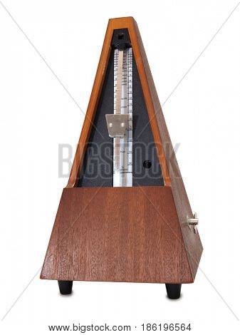 Old mechanical metronome on a white background