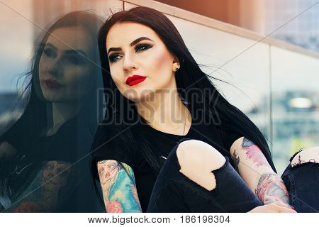 Tattoed Beauty. Portrait Of Beautiful Attractive Tattoed Hipster Girl Posing To Camera While Sitting