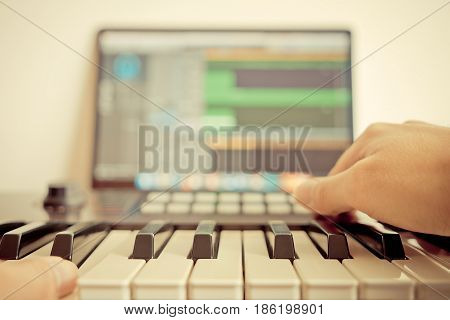 Music keyboard player is recording song on computer DAW music station