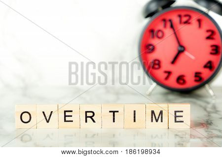 Overtime clock with text on marble copy space