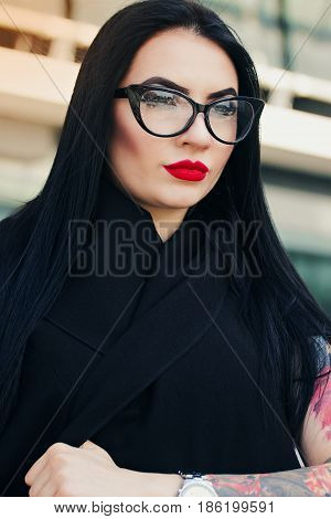 Gothic Beauty. Closeup Of Beautiful Tattoed Hipster Girl Posing To Camera While Standing Against Urb