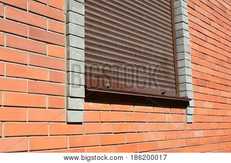 House window with Security Shutters Grilles. Security shutters roller shutters security gates retractable security. Window with rolling shutter for house protection.