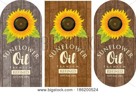set of three vector labels for refined sunflower oil with sunflower and the inscription on wooden background