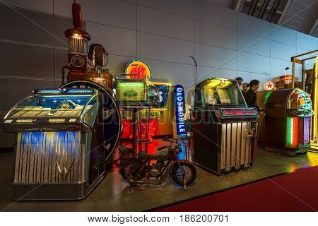 STUTTGART GERMANY - MARCH 02 2017: Various retro musical jukeboxes. Europe's greatest classic car exhibition