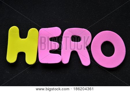 word hero on a  abstract black background