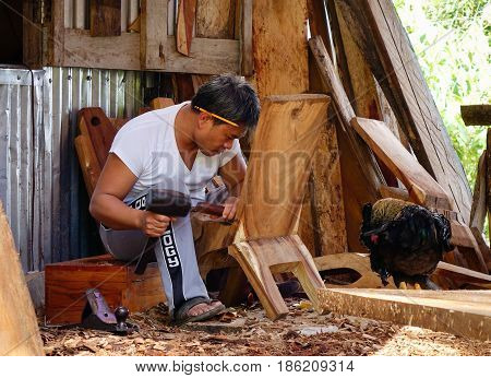 Carpenter Working At The Wood Factory