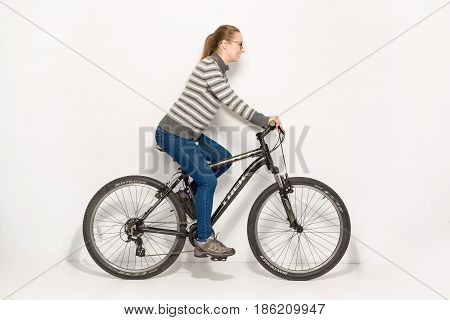 Gomel, Belarus - May 12, 2017: Mountain Bike Track On A White Background. The Girl Is Riding.