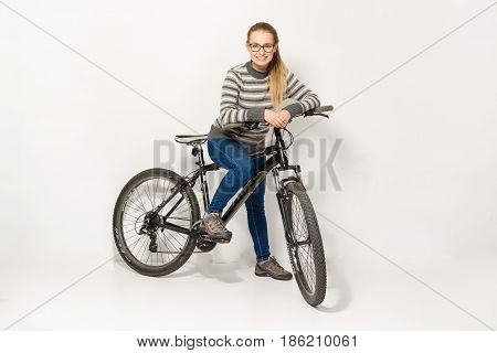 GOMEL BELARUS - May 12 2017: Mountain bike TRACK on a white background. The girl is riding