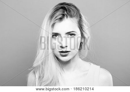 Black and White Portrait of Temperamental Sad Blonde with Long Hair Posing in Studio.