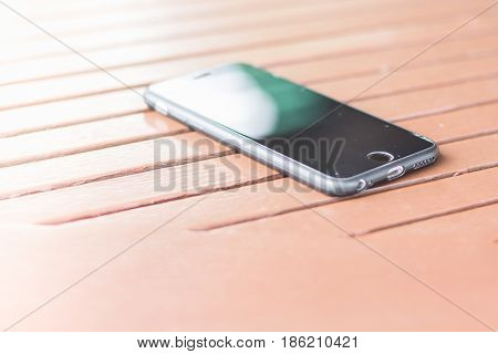 blurred of smart phone on the bed. Abstract mobile phone on bed.