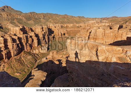 Charyn Canyon a journey across Kazakhstan the shadow of the photographer on the cliff sights of Kazakhstan