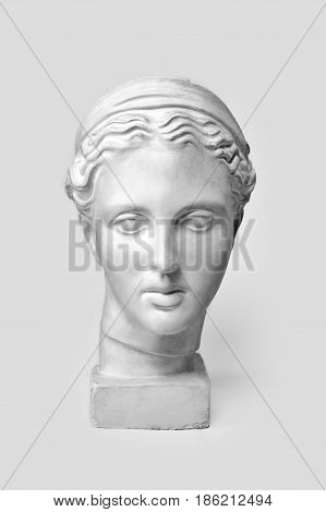 Marble head of young woman, ancient Greek goddess bust. Sculpture executed in accordance with modern standards of beauty isolated on white background.